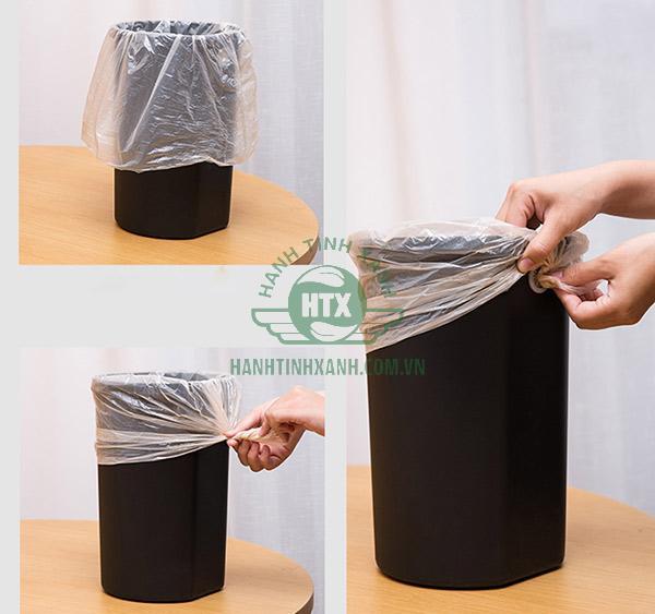 Lót túi đựng rác trong lòng thùng rác inox